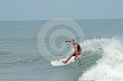 Male Surfer Surfing Wrightsville Beach, NC Editorial Image