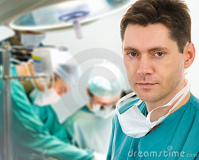 Male surgeon with his team