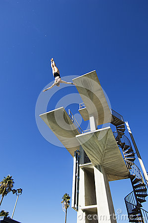 Male Swimmer Diving In Midair