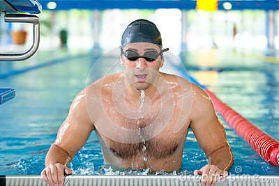 Male swimmer getting ready for competition