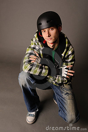 Male teen in helmet