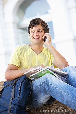 Male Teenage Student Sitting On College Steps