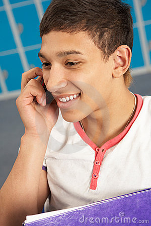Male Teenage Student Using Mobile Phone