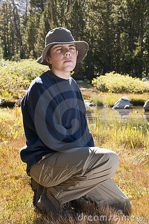 Male teenager in countryside