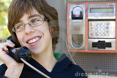Male teenager talking on phone
