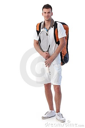 Male tennis player going for training smiling