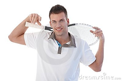 Male tennis player taking a break smiling