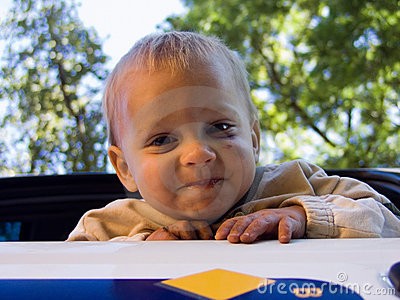 Male toddler playing outdoors