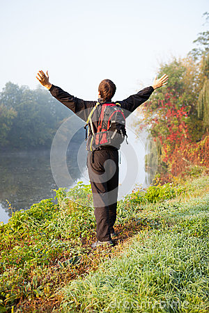 Male tourist with outstretched hands.