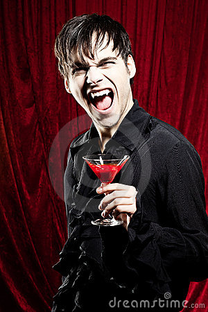 Male vampire with a bloody drink