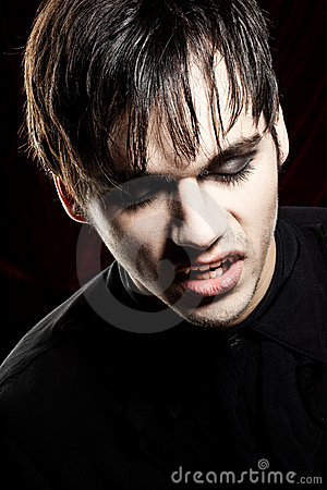 Male vampire with open mouth looking down