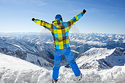 Male wearing ski equipment on top of world