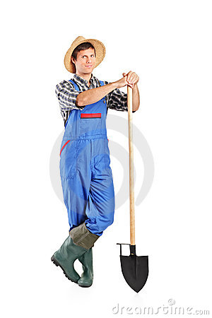 Male worker holding a shovel