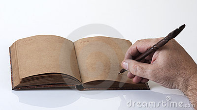 Male writing on a recycled paper notebook