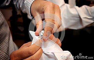 Man adjusting sleeve cuff