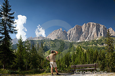 Man admiring a breathtaking alpine scenery