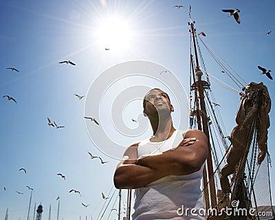 Man against boat s mast
