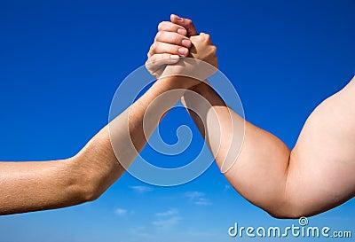 Man Against Woman in Arm Wrestling