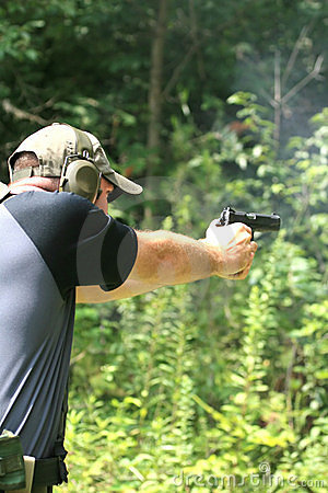 Free Man Aiming Pistol - Sideview Royalty Free Stock Image - 2405246