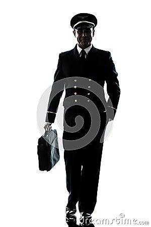 Man in airline pilot uniform silhouette walking