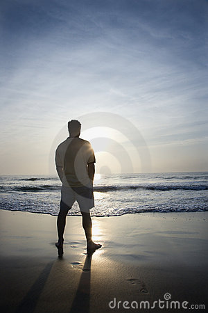Man alone on beach.