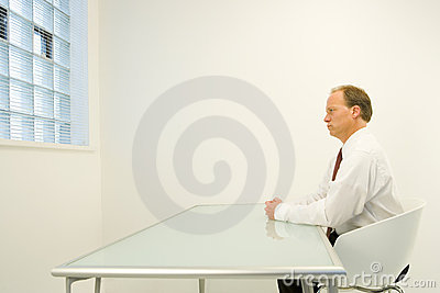 Man alone in white room