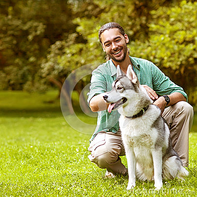Free Man And Dog In The Park. Royalty Free Stock Image - 42712436