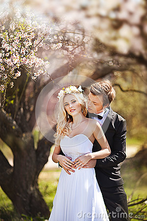 Free Man And Woman In The Blossoming Garden Royalty Free Stock Photos - 68163828
