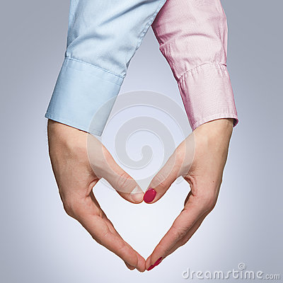 Free Man And Woman Make A Shape Of A Heart With Hands Royalty Free Stock Photos - 82624178