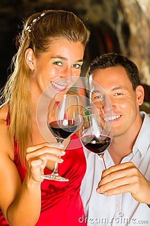 Free Man And Woman Tasking Wine In Cellar Royalty Free Stock Photos - 28158058