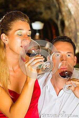 Free Man And Woman Tasking Wine In Cellar Stock Photos - 28158113