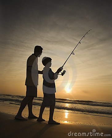 Free Man And Young Boy Fishing In Surf Royalty Free Stock Photo - 12543485