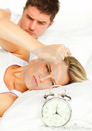 Man and angry woman in bed
