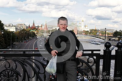 Man with apples on bridge. Moscow