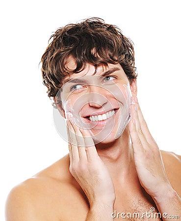 Free Man Applying Moisturizing Cream After Shaving Stock Photography - 11207852