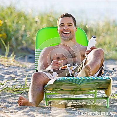 Man applying sunscreen lotion at beach