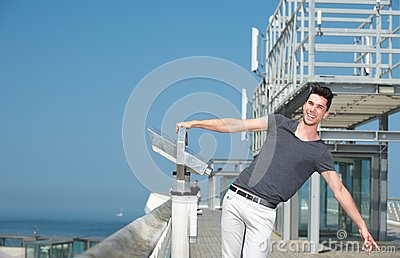 Man with arms outstretched on a summer day