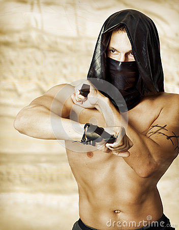 Free Man Assassin With Torso In Mask Royalty Free Stock Image - 25874136