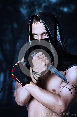 Free Man Assassin With Torso In Mask Royalty Free Stock Photo - 25877645