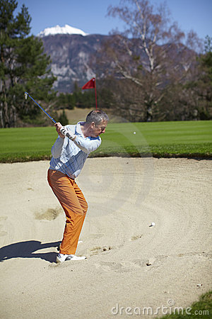 Free Man At The Bunker On A Golf Course Royalty Free Stock Photography - 14184087