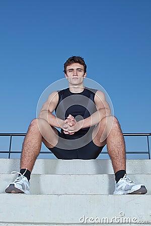 Man athlete resting.