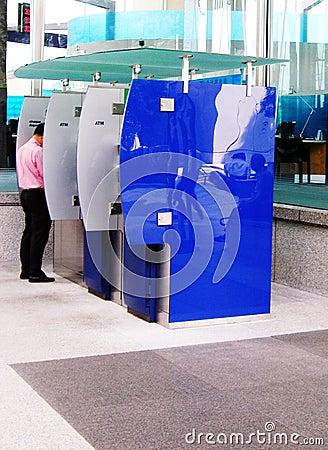 Man at ATM machine, city