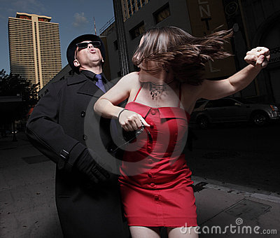 Man attacking the woman