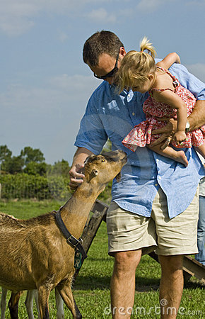 Man and baby with goat