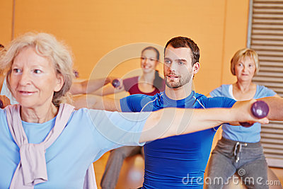 Man in back training class in gym