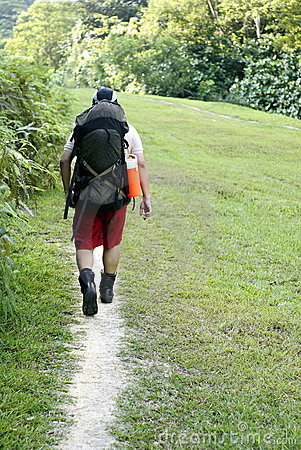 Man backpacking outdoors