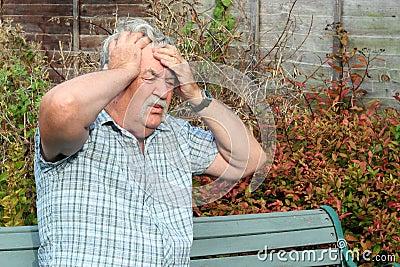 Man with a bad headache.
