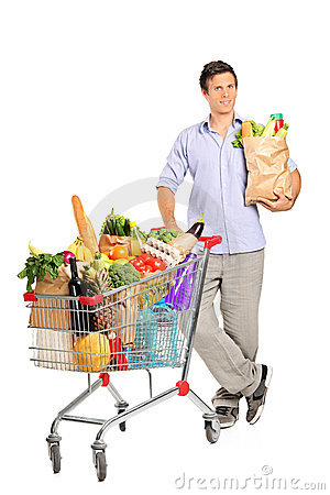 Man with bag next to a shopping cart