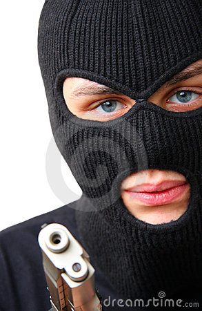 Man in balaclava with gun
