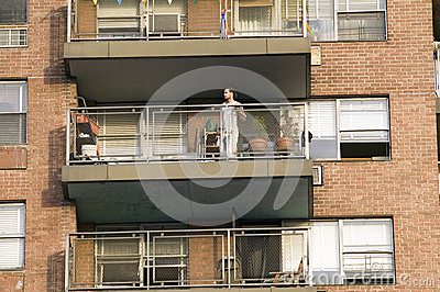 Man on balcony in t-shirt Editorial Photo